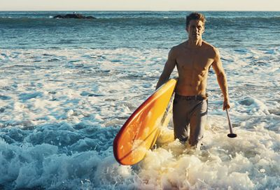 Matthew_Morrison_surfboard_in_water_HEmbed