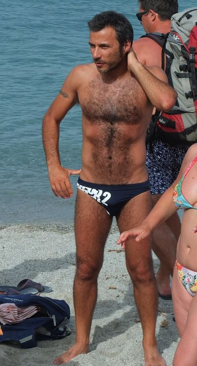 Sexy hairy man in Speedo