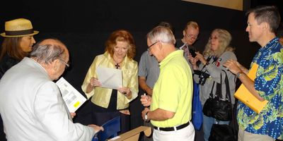Samantha Eggar with fans signing